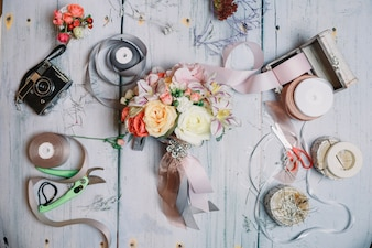 Top view of rustic composition with bouquet