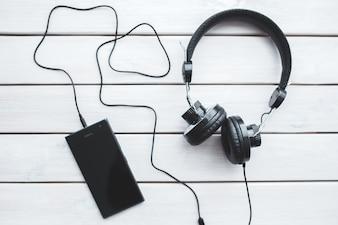 Top view of smartphone with headphones