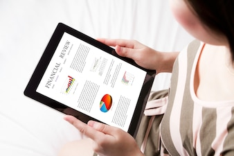 Top view of tablet with a financial review