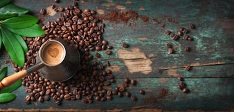 Top view of tasty coffee with coffee beans