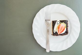 Top view of tasty dessert with a strawberry slice