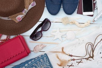 Top view of traveler women's outfit and accessories