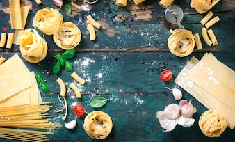 Top view of wooden table with variety of pasta