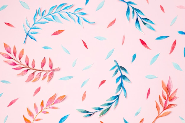 Top view tropical leaves on pink background
