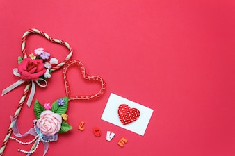 Top view valentines day background and decorations.love shape  bouquet gift and greeting card on red background with copy space.