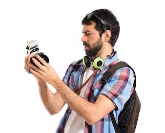 Tourist holding a video camera
