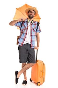 Tourist holding an umbrella