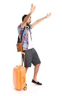 Tourist saluting over white background