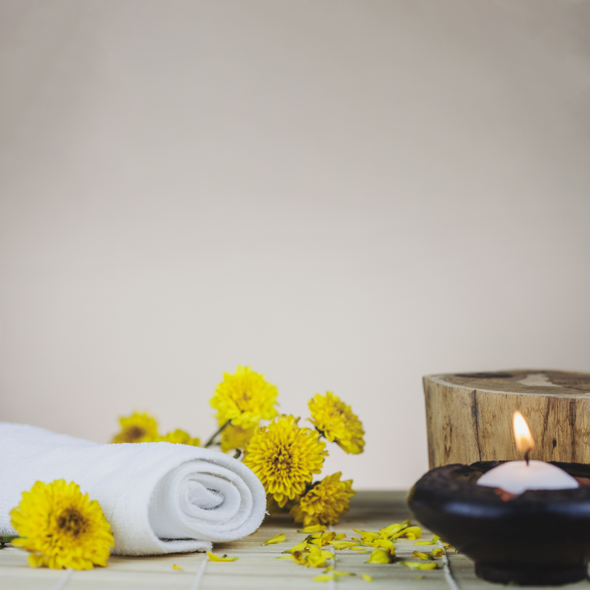 Towels, flowers, trunk and candle