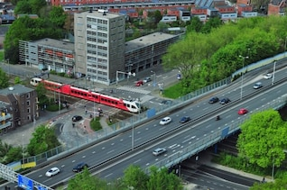 Train crossing overpass in the city