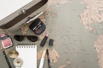 Travel background with suitcase and beauty accessories