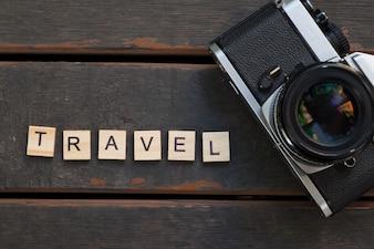 Travel Concept - Camera and travel alphabet