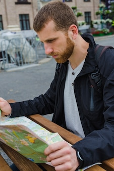Traveller reading map at table