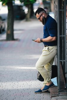 Trendy man checking his email