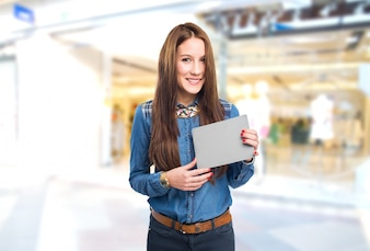 Trendy young woman holding a grey card