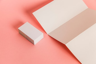 Trifold paper and stack of business cards
