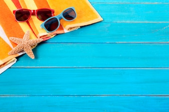 Tropical beach background with sunglasses