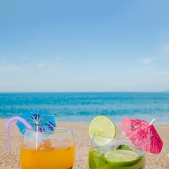 Tropical cocktails on background of ocean