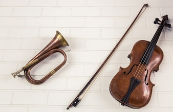 Trumpet next to a violin