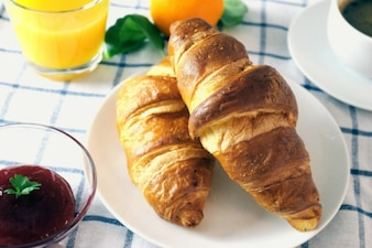 Two croissants and jam