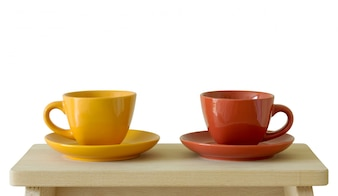 Two cups on wooden board