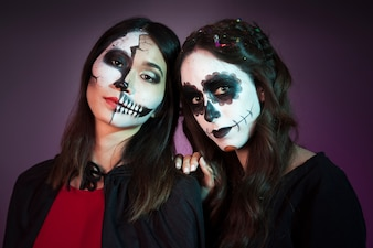 Two friends dressed as witches