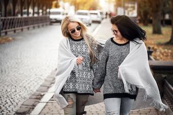 Two friends walking down the street