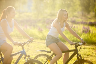 Two girls having a good day with bikes