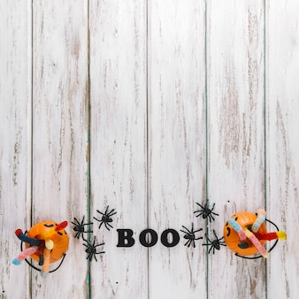 Two pumpkin baskets and boo caption