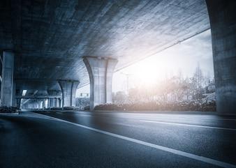 Under a bridge at sunset