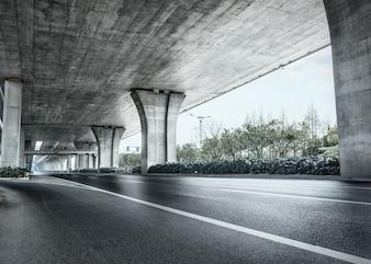 Under a concrete bridge