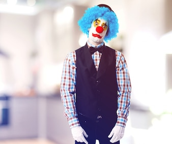Upset clown with blue wig