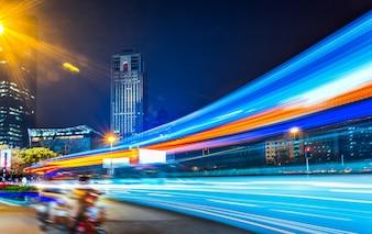 Urban night scene and light path of vehicle running