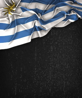 Uruguay Flag Vintage on a Grunge Black Chalkboard With Space For Text