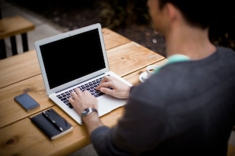 Using laptop on office desk