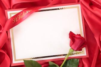 Valentine card on red silk