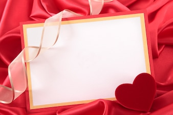Valentine card with a ribbon and a heart