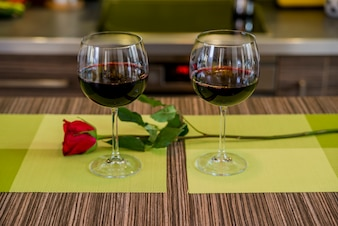 Valentines day: glasses of vine, red roses, for romantic evening