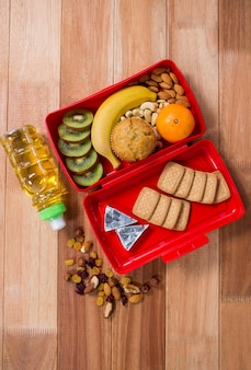 Various snack, fruit and oil on wooden table