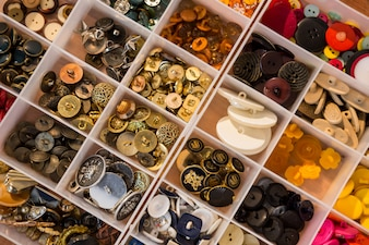 Various types of buttons in a box