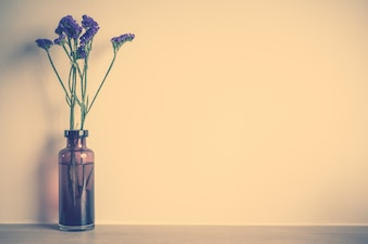 Vase with purple flowers