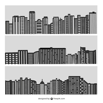 Vector city buildings silhouette on grey
