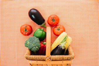 Vegetable composition on cloth with basket