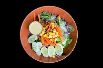 Vegetable salad isolated on black background