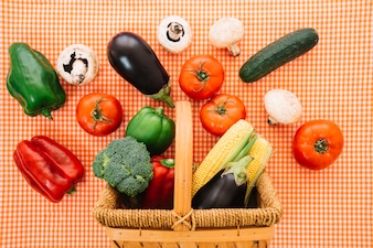 Vegetables and basket on cloth