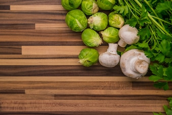 Vegetables on wood. Bio Healthy food, herbs and spices. Organic vegetables on wood. Frame with green organic vegetables on wooden background with copy space