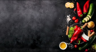Vegetables set to the left of a black slate