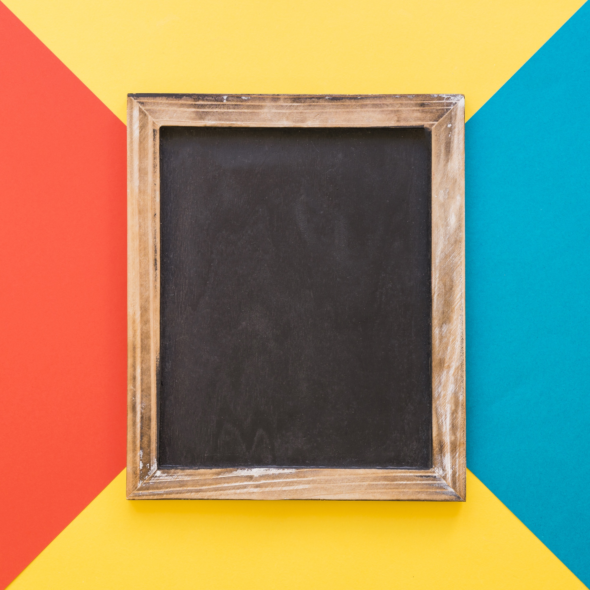Vertical slate on colorful geometric background