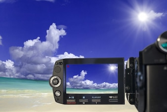 Video camera recording a beach