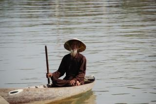 Vietnamese man on a boat